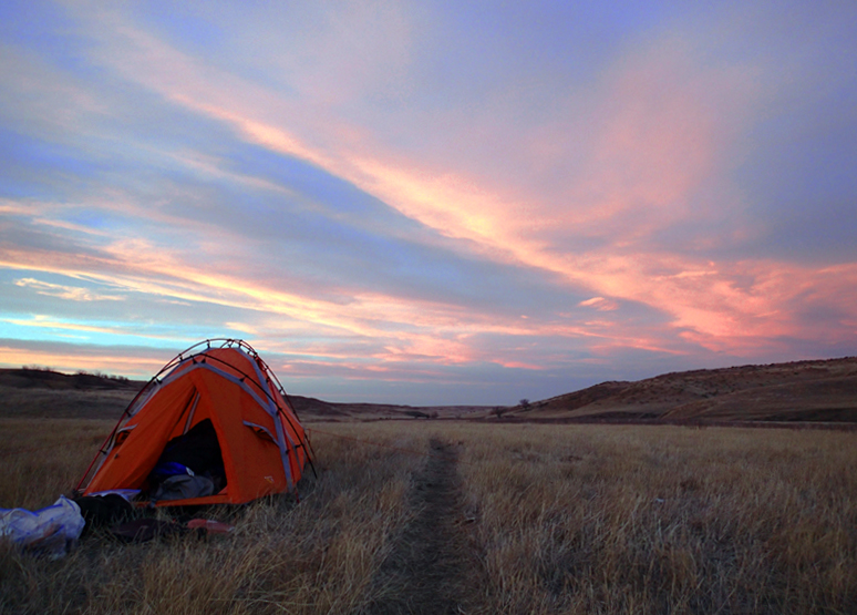 Ken Ilgunas' tent is pitched in a field somewhere in Montana.