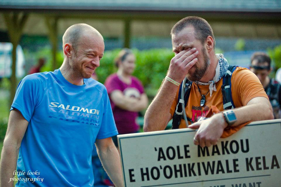 Gary Robbins, left, shares an emotional moment with HURT 100 runner Ken Michal minutes after Michal finished the hundred-miler for the first time after four attempts. Photo courtesy Chuck Little of Little Looks Photography.