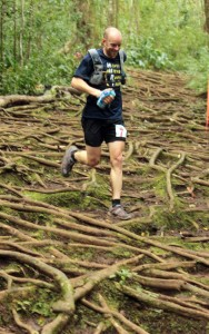 Gary Robbins runs the Pauoa Flats Trail during the  HURT 100. Photo by Rob Lahoe.