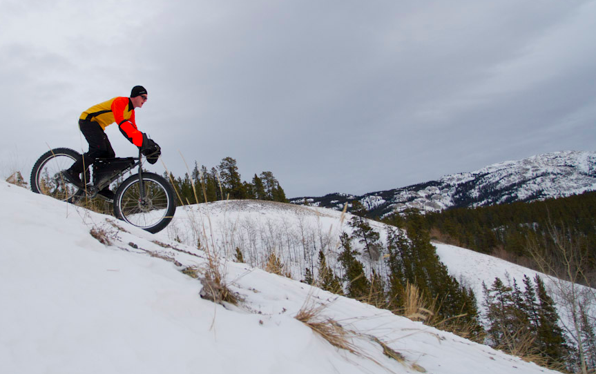 A rider participates in the 2011 5+ Hours of Light Fat Tire Festival in Whitehorse, Yukon, in December 2011. Photo by Tim Hogan