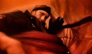 Tim Williamson inside his bivy sack during a storm while training in Iceland.