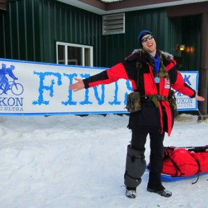 Tim Williamson at the finish line of the 2012 Yukon Arctic Ultra, a 300-mile winter trail race.