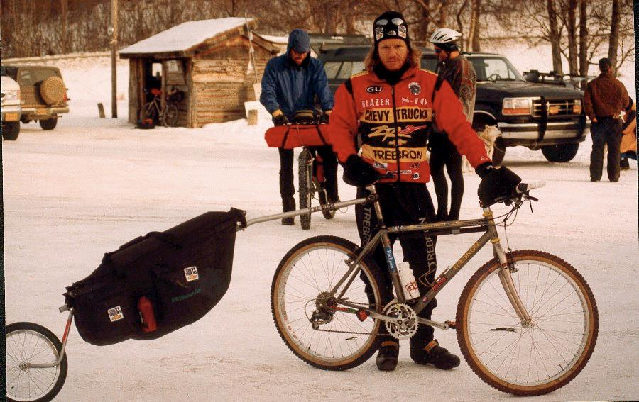 John Stamstad poses with his mountain bike and trailer set-up before the 1997 Iditasport Extreme. Photo by Charles Bingham.
