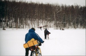 Racers push bikes across Knik Lake at the start of the 1997 Iditasport Extreme. Photo by Charles Bingham.