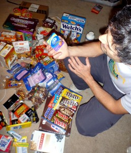 Contemplating antacids atop a mountain of junk food.