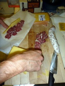 Preparing salami and cheese tortillas for a tasty Iditarod dinner.