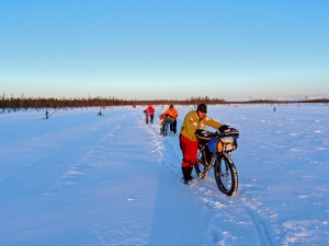 Cyclists push their bikes across a frozen swamp during the 2009 Iditarod Trail Invitational. Photo by Jill Homer