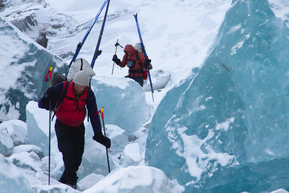 Josh Mumm and John Sykes negotiate ice boulders on the Nebesna Glacier during the 2013 Alaska Winter Wilderness Classic, an approximately 170-mile traverse of the Wrangell Mountains. Photo by Luc Mehl.
