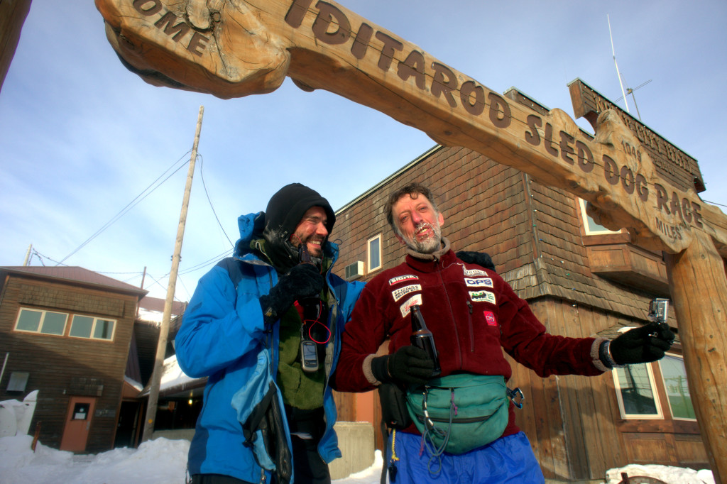 Beat Jegerlehner and Marco Berni celebrate the finish of their thousand-mile walk to Nome, Alaska. The two completed the journey in 28 days and 4 hours.