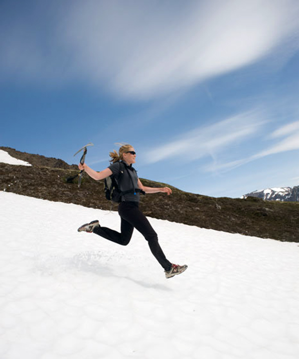 Jill Homer descends a snowfield in the Chugach Mountains outside Anchorage in June 2010. Photo by Dan Bailey, http://danbaileyphoto.com.