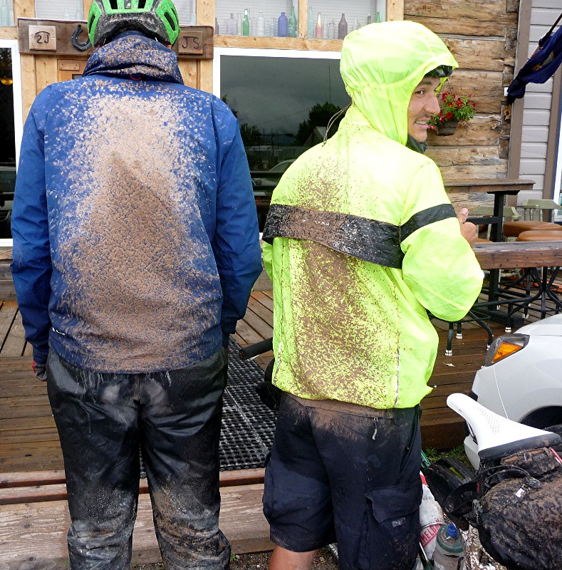 Tour Divide riders display a solid coating of mud in Ovando, Montana.