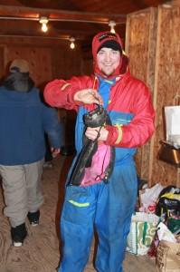 Always happy to help —Billy Koitzsch adjusts a racer's boots.